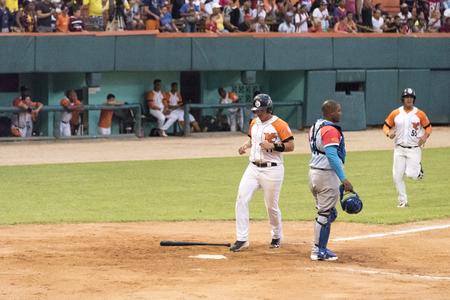 General scene of Cuban baseball or National Series. Game between Villa Clara and Ciego de Avila teams at the Sandino Stadium. Scoring a run