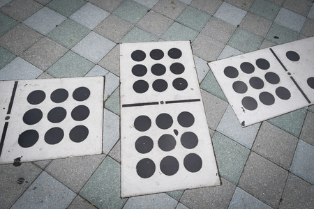 Symbols of the Cuban exiles and immigrants nostalgia in Little Havanas Calle Ocho. Dominoes pieces as decoration in city plaza. Domino plaza. Stock Photo
