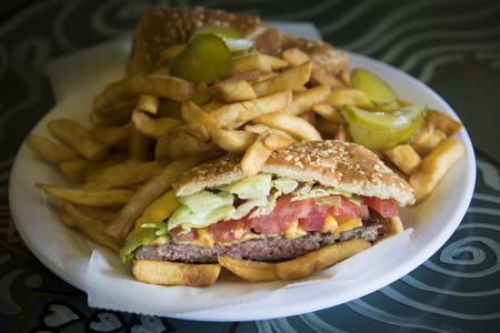 Real food served in restaurants: hamburger in sesame bread and fries served in Little Havanas Calle Ocho Cuban restaurant. Reklamní fotografie