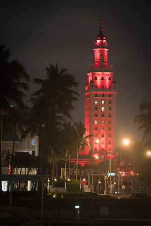 Freedom tower at night lit in red light. The Freedom Tower is a building in Miami, Florida, designed by Schultze and Weaver. It is currently used as a contemporary art museum and a central office to different disciplines in the arts associated with Miami