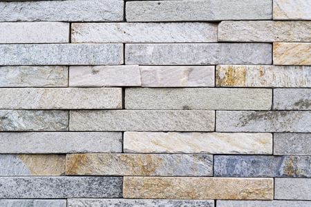 Pattern and texture of a wall with rectangular shaped rocks. Architectural detail of building in Toronto city.