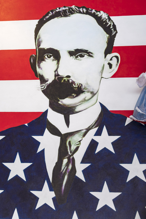 Jose Marti portrait with the United States flag colors around him. Symbols of the Cuban exiles and immigrants nostalgia in Little Havanas Calle Ocho Editorial
