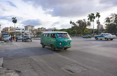 Old vintage American cars in the Cuban capital city. Due to lack of vehicle supply, Cubans have been forced to maintain obsolete vehicles working and they are now a tourist attraction