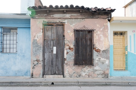 Cuban old weathered and worn out architecture. Urban contrast.  Results of economic hardship on real estate.