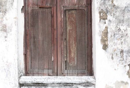 Cuban old weathered and worn out architecture. Close-up detail of wooden window.  Results of economic hardship on real estate. Редакционное