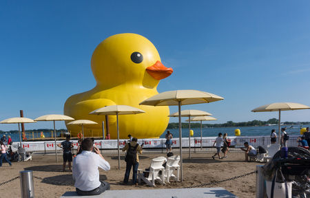 was: Toronto, Canada- June 30, 2017: Giant Rubber Duck known by its owners as Mama Duck is in the city harbourfront or waterfront. The piece is the largest in the world and was brought to celebrate Canadas 150th Anniversary