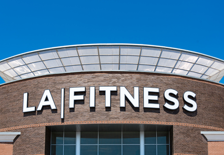 La Fitness establishment entrance with companys logo on the wall.  LA Fitness is a privately-owned American health club chain with over 800 clubs across the United States and Canada.