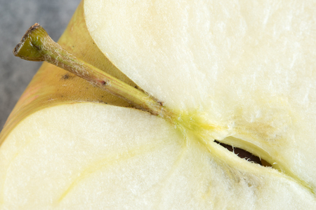 originate: Close up details of an apple. The apple is a round red or yellow edible fruit of a small tree named Malus sylvestris (from which cultivated varieties originate) Stock Photo