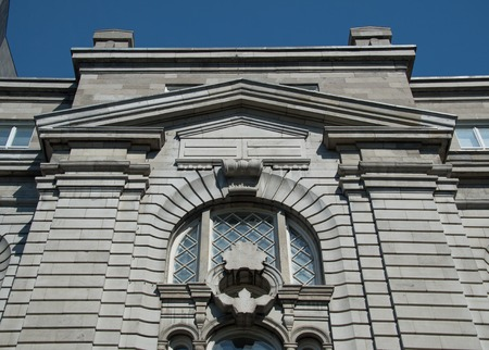Vintage architectural features of the Finance Services building. The historic city of Old Montreal is a Unesco World Heritage Site and tourist attraction.