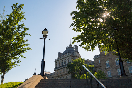 Stairs leading to Old Montreal. The Finance Services Montreal building which is a government building in the background. Editorial