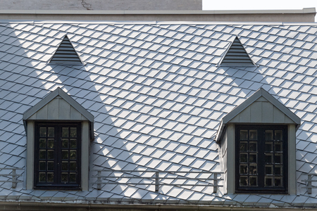 Old Montreal architectural feature of a building roof. Stock Photo