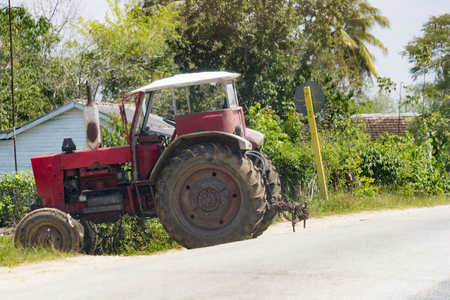 Cuban transportation: Russian tractor parked on a hill. The practice allows starting the vehicle without a battery. The Caribbean Island is known for the diversity of vintage cars still driving on its streets.