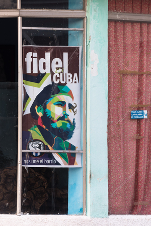 Fidel Castro poster on a window glass belonging to the CDRs headquarters building. After the passing of the Cuban leader, a surge of his images is more common in Cuban streets