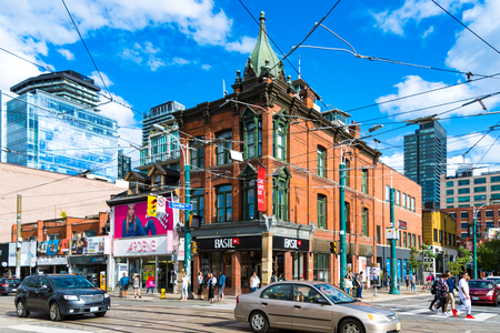 The 441-443 Queen St. West heritage building (red bricks). Architectural contrasts and the everyday lifestyle in the area.