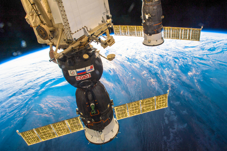 Outer Space-December 30, 2017: Awesome view of the planet Earth and the Soyuz spaceship docked to the ISS. T Stock Photo