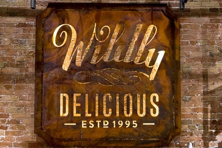 Wildly Delicious Fine Foods sign.  The cozy store and cafeteria is located in the Historic Distillery District 報道画像