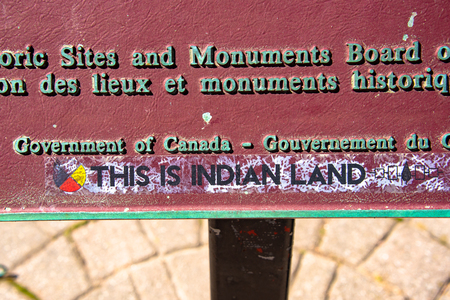 Canadian First Nations occupy the Old City Hall in protest to diverse social issues they are facing. This is Indian Land written on the historic plaque at the downtown landmark building.