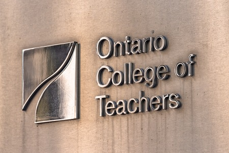 The Ontario College of Teachers plaque at the entrance of the building. The organization licenses, governs and regulates Ontario's teaching profession.