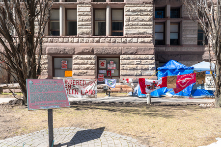 Canadian First Nations occupy the Old City Hall in protest to diverse social issues they are facing. General view of signs, flags and tents.