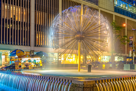 Dandelion fountain at night in Midtown Manhattan, New York city, USA.