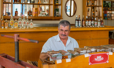 The House of Cigars is a government run business specializing in all brands of the world famous Cuban Cigars, they roll cigars in front of buyers and have boxes and a bar. Редакционное