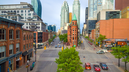 Aerial view. Architecture contrasts between the Old Toronto and the skyscrapers in the downtown district of the Canadian city. The Gooderham Flatiron building can be seen in the centre of the image.