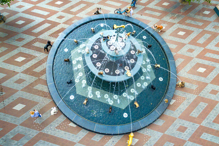 The dog fountain at Berczy Park, aerial view from a drone. The famous place and tourist attraction is located in Old Toronto and it has a triangular shape.  The park is named after William Berczy, an architect and surveyor who helped in the design of York city which later became Toronto