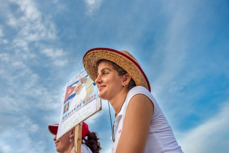 Scenes of Pope Francis to Havana, specifically the historic Catholic Mass held in the Revolution Square. Young lady holding a Papa Francisco sign. General public attending the religious mass. DATE: Sept. 20, 2015 Editorial