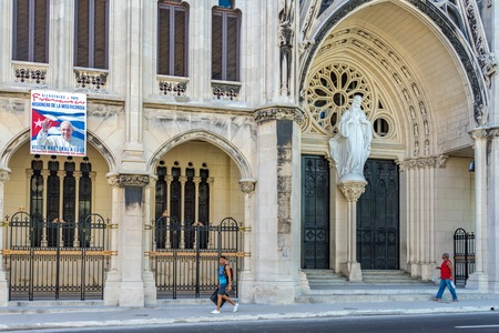 Popularly known as Reina Church, the Parish of the Sacred Heart of Jesus and St. Ignatius of Loyola is one of the most beautiful Catholic temples in Cuba. Exterior details and the everyday life in the Cuban capital days before the visit of Pope Francis. D