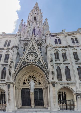 Popularly known as Reina Church, the Parish of the Sacred Heart of Jesus and St. Ignatius of Loyola is one of the most beautiful Catholic temples in Cuba. Exterior details and the everyday life in the Cuban capital days before the visit of Pope Francis. D Banco de Imagens - 106712144