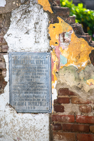 Historic plaque in the ruins of the Public Laundry Rooms donated to the city by Marta Abreu. The plaque explains that the place had been turned into a public school in 1928