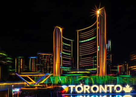 Toronto, Canada: New City Hall at night in the Nathan Phillips Square. Effects applied for creative purpose. Sajtókép