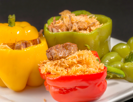 Cuban Cuisine: Bell Peppers Stuffed with Yellow Rice and pork meat. Creative presentation of a popular dish for dinner or lunch in the Caribbean Island. Stock fotó