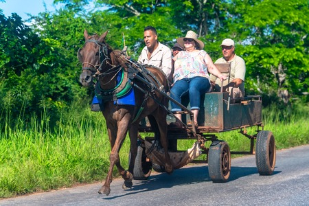 A family moving on a horse drawn cart which is driving on a rural road. After the fall of the communist bloc, the vehicle has become an important mode of transport in the Caribbean island Editorial