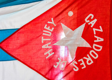 Old heritage Cuban flag in Vicente Garcia house. It reads Hunters of Hatuey ( Cazadores de Hatuey)  surrounding the star.
