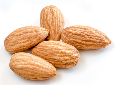 Raw almonds over white background