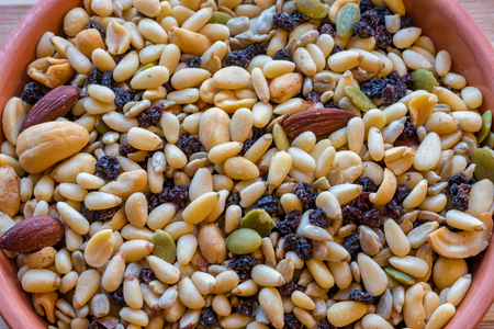 Various seeds and dried fruit mixture. Seeds and dried fruits are source of protein for vegetarians and vegans. Currently, healthy eating includes both foods as an integral part.