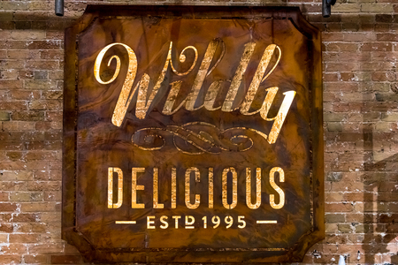 Toronto, Canada- December 22, 2017: Wildly Delicious Fine Foods sign.  The cozy store and cafeteria is located in the Historic Distillery District
