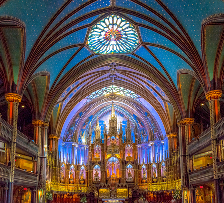 Notre-Dame Basilica indoor detail of altar. The Catholic church is one of the crown jewels in Quebecs rich religious heritage. 스톡 콘텐츠
