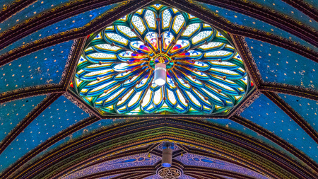 Skylight and ceiling at Montreals Notre Dame basilica Catholic church. Roof stained glass skylight.  Beautiful colors and architecture of the famous place tourist attraction.