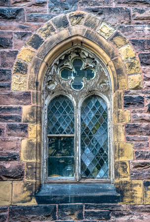 Saint James United Church weathered wood and glass window architectural detail. The famous heritage church is a Protestant church affiliated with the United Church of Canada.