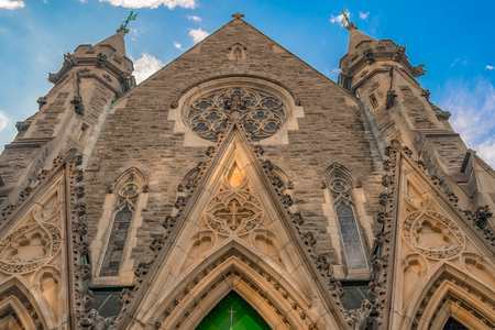 Facade of the Christ Church Cathedral which is an Anglican Gothic Revival building. It is the seat of the Anglican Diocese of Montreal.