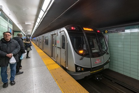 TTC Bombardier train spotted in Saint George subway station. Incidental people show the city life in the underground transportation system Editorial