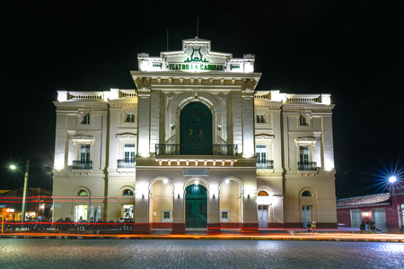 Long exposure of the Charity Theater facade at night. The landmark colonial building is a major tourist attraction in the city