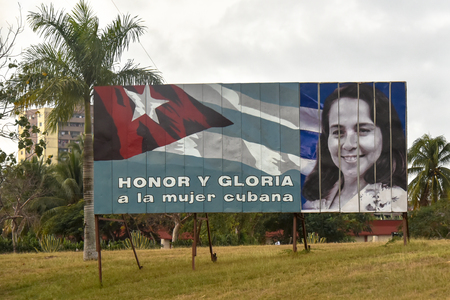 Vilma Espin image on a road billboard at the entrance of the city. The billboard reads: Honor and Glory to the Cuban Women