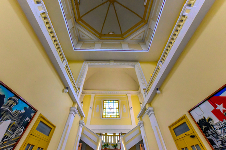 Indoor view of the Palace of Government, also the Provincial Popular Power Assembly. The beautiful old building is located in the 'Parque Jose Marti' which is a Unesco World Heritage Site Stock Photo - 118674223