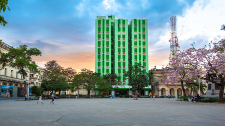 Panorama of the Leoncio Vidal Park and Santa Clara Libre Hotel during the sunset hour. There is a beautiful contrast of orange and blue colors in the sky. Wide angle view of the National Monument area
