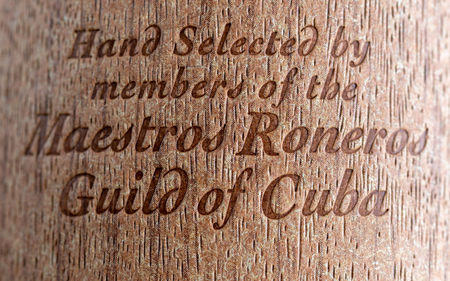 Master's Selection Havana Club Rum. Text engraved in the wood container. It reads: 'Hand Selected by Members of the Maestros Roneros  Guild of Cuba'. The brand Havana Club is the most frequently sold and exported Cuban rum