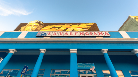 Low angle view of a Che Guevara sign over the TRD store La Valenciana. The store is located in El Prado which is a famous place and tourist attraction in the city