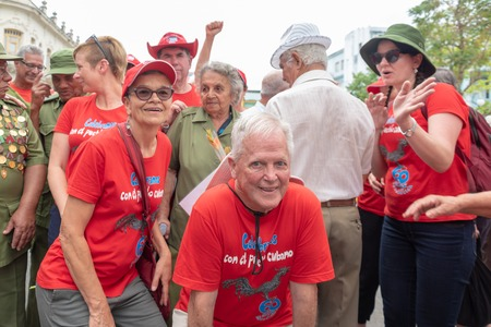 Santa Clara, Cuba-January 6,2019:   Members of the Southern Cross Brigade (red t-shirts) from Australia mingle with Cuban veterans of the Revolution. The Victory Caravan celebrating the entrance of Fidel Castro to the city in January 6, 1959. Editorial